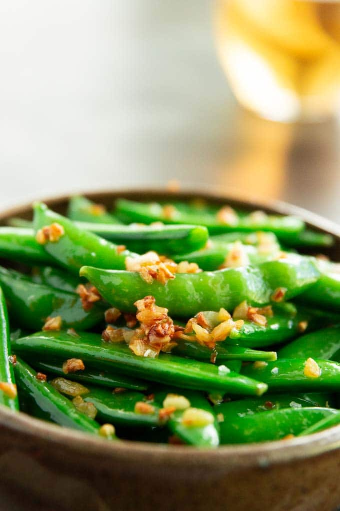 crispy garlic atop healthy sugar snap peas