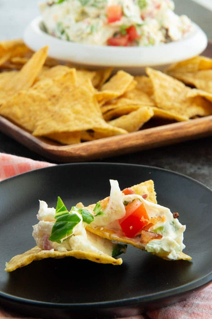 serving plate with tortilla chips with blt dip on them