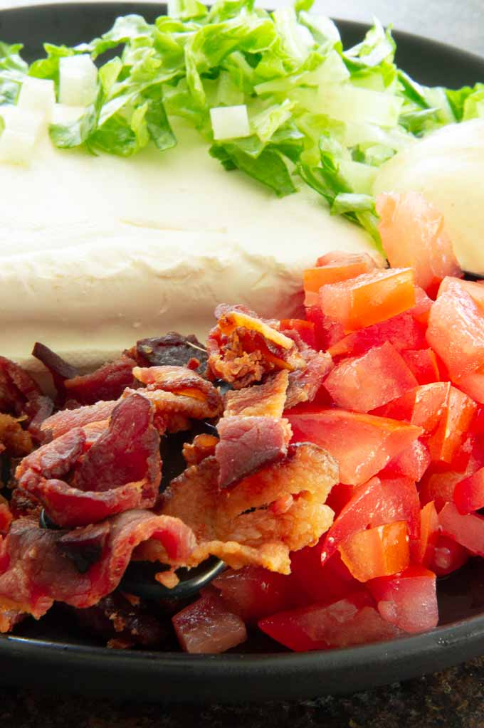 bacon, lettuce, cream cheese and fresh tomatoes ready to go in a bowl