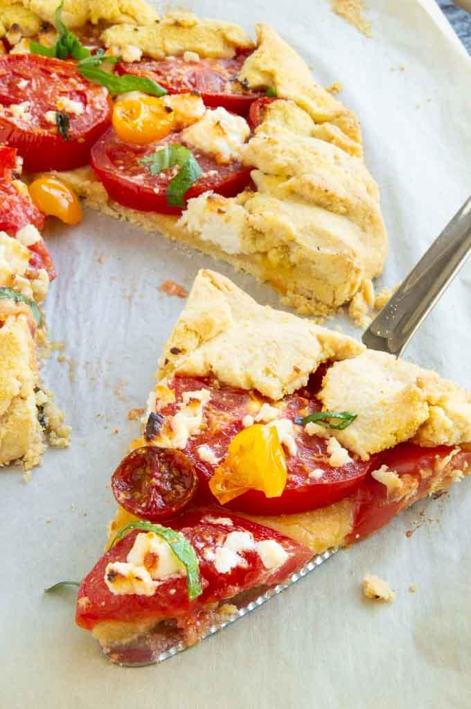 Slice of tomato tart ready for serving