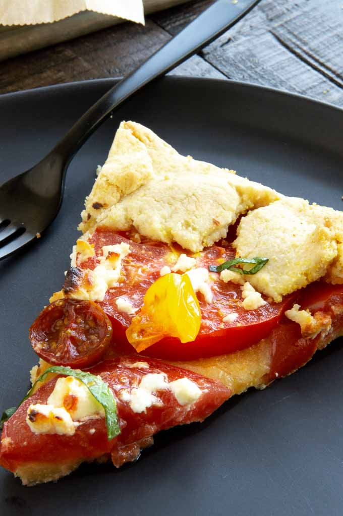 Getting ready to eat a tomato tart with fresh goat cheese