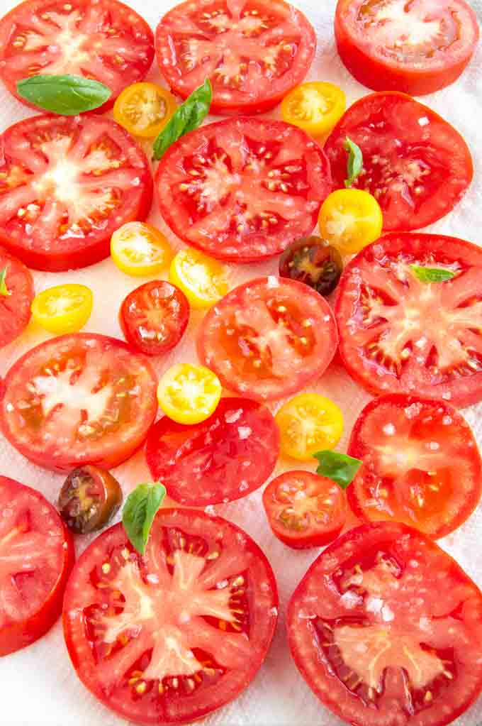 Fresh tomatoes for a tomato tart letting the juice soak out