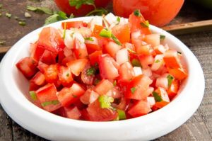 close up of chopped tomatoes, onions and jalapeños in pico de Gallo