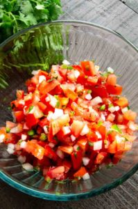 pico de Gallo in a glass bowl.
