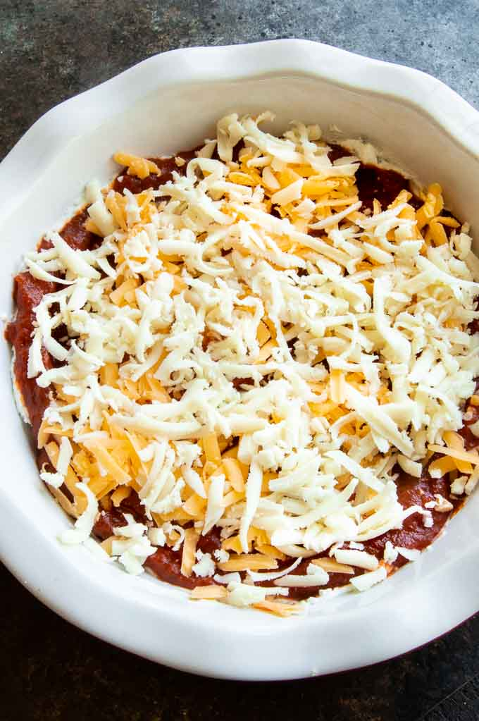 step 3 of making dip, sauce, cheese, cheese