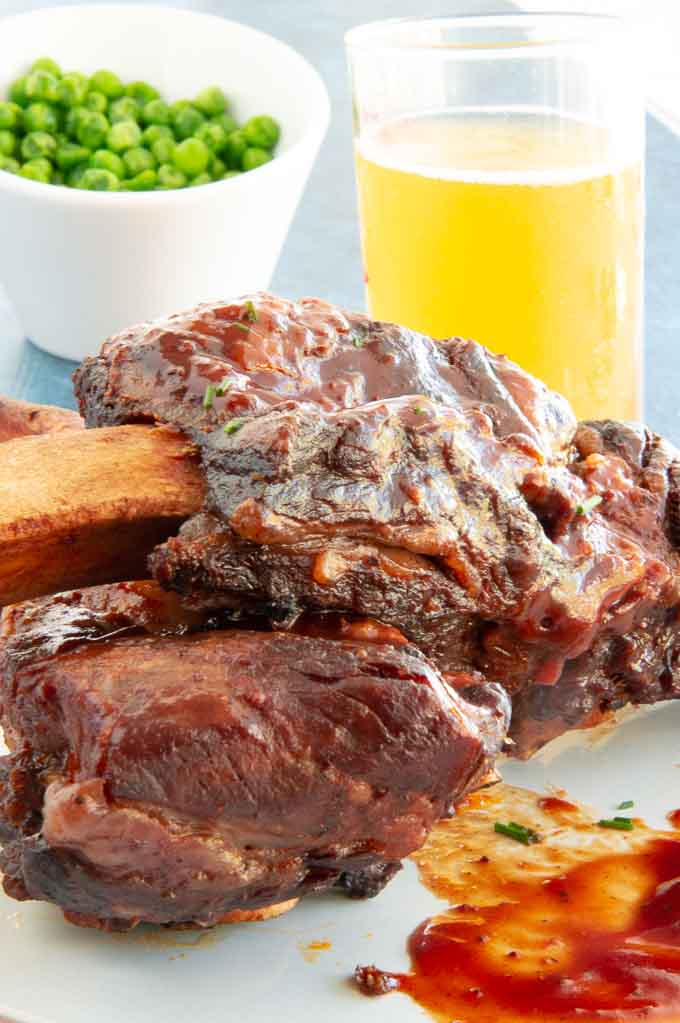 sauced ribs on a plate next to an instant pot