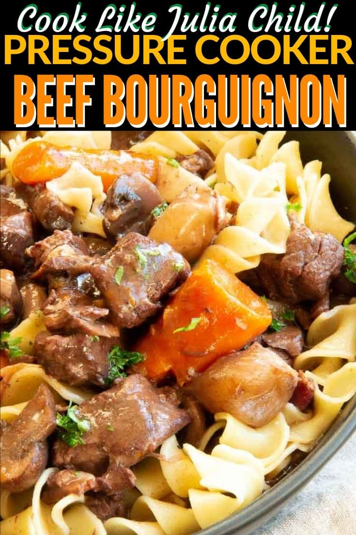 close up carrots, beef and noodles in a pan