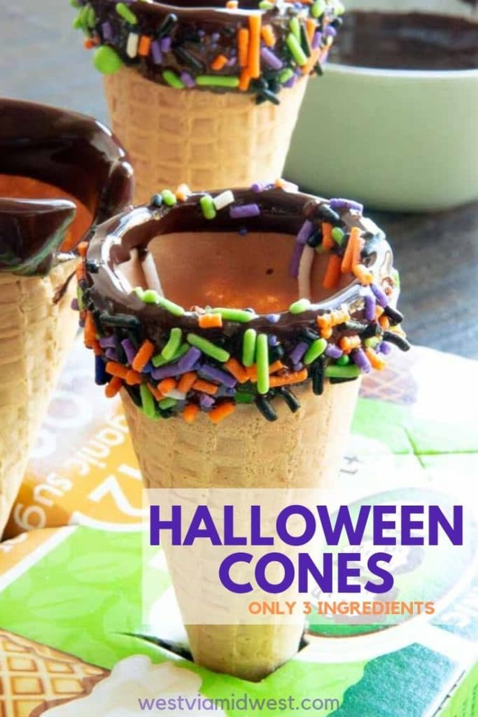 Ice cream cones dipped in chocolate with halloween colored sprinkles in a box