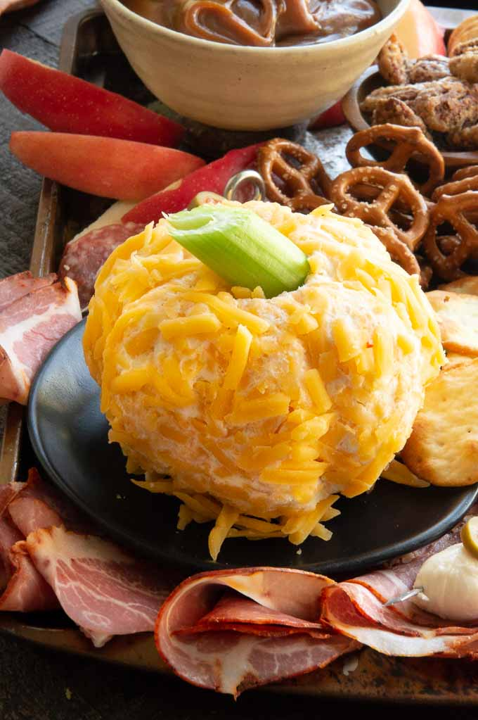Close-up of pumpkin shaped cheese ball on a tray