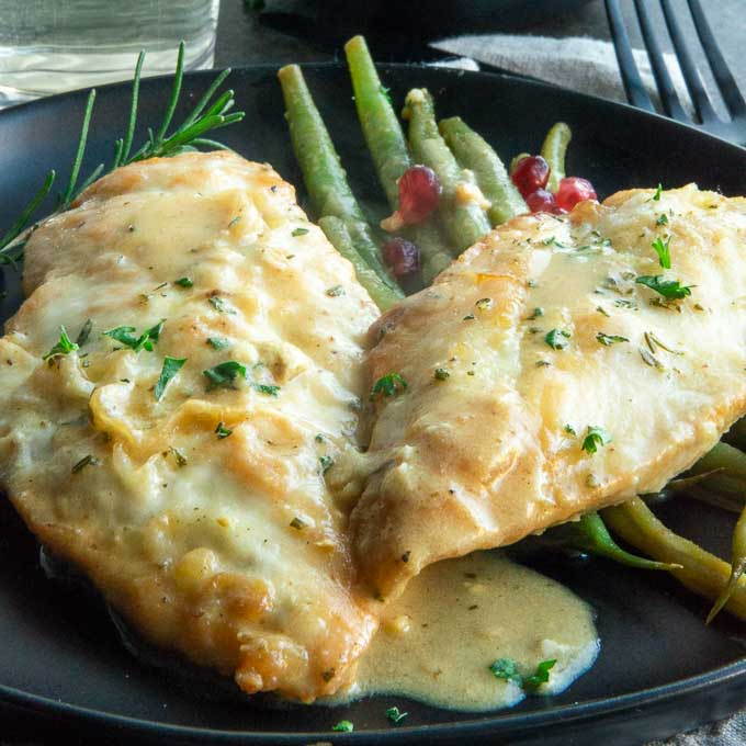plate of chicken skillet with mustard and rosemary sauce