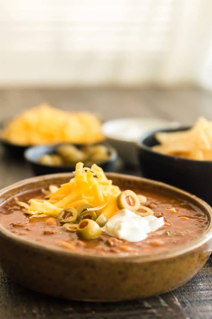Bowl of chili topped with cheese