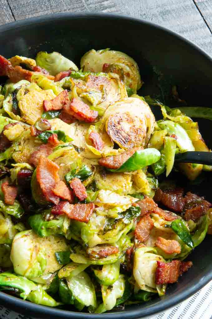 Serrving Bowl of Shaved brussel sprouts and bacon