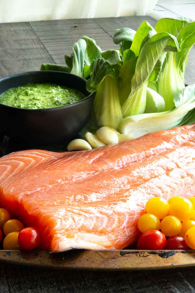 Fresh Sockeye Salmon, Bok Choy, Garlic, tomato, and pesto for sheet pan fish