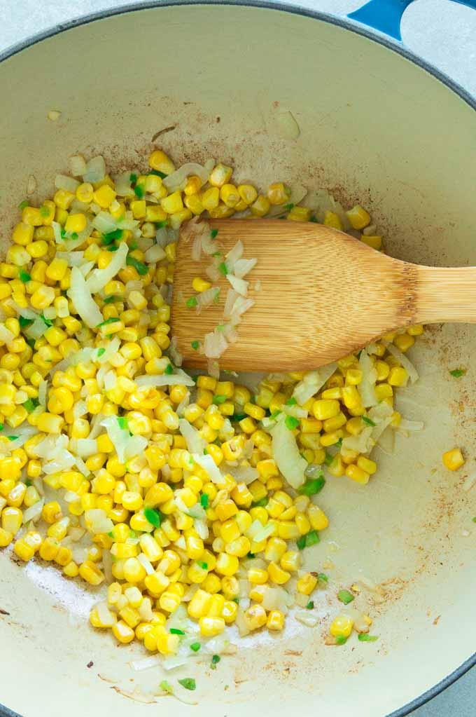 Sauteeing corn, jalapenos onions and garlic