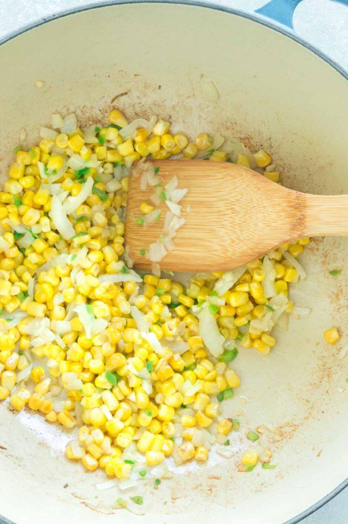sautéing corn and onions