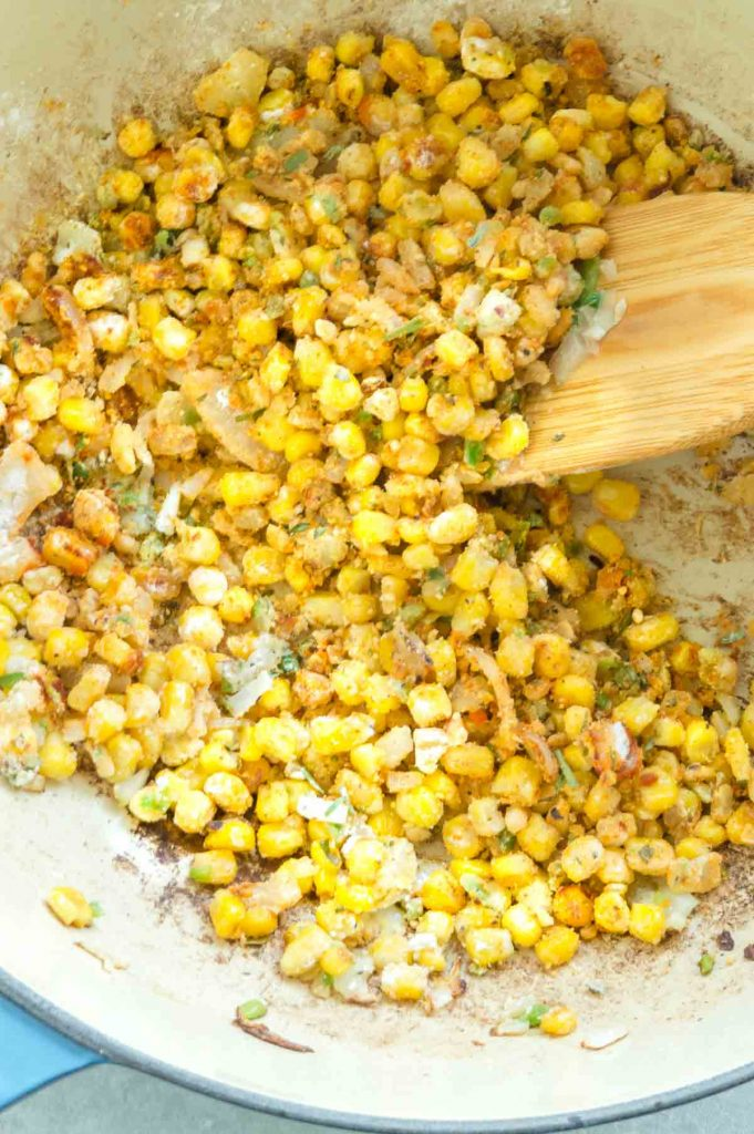 mixing spices into corn