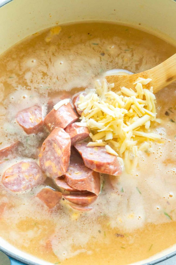adding corn and brats to soup