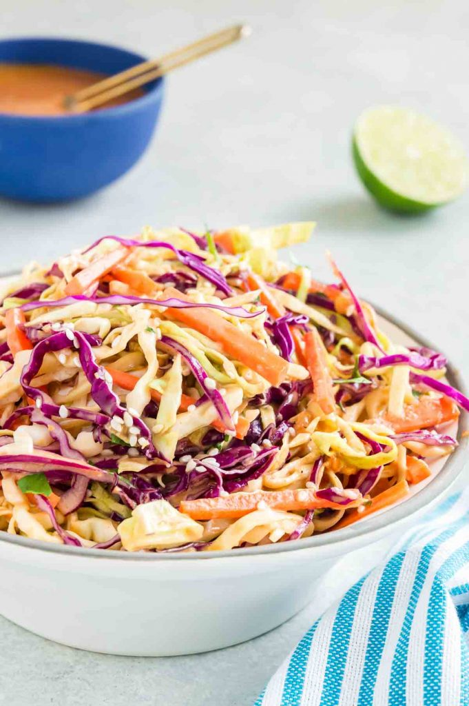 asian slaw in a white bowl