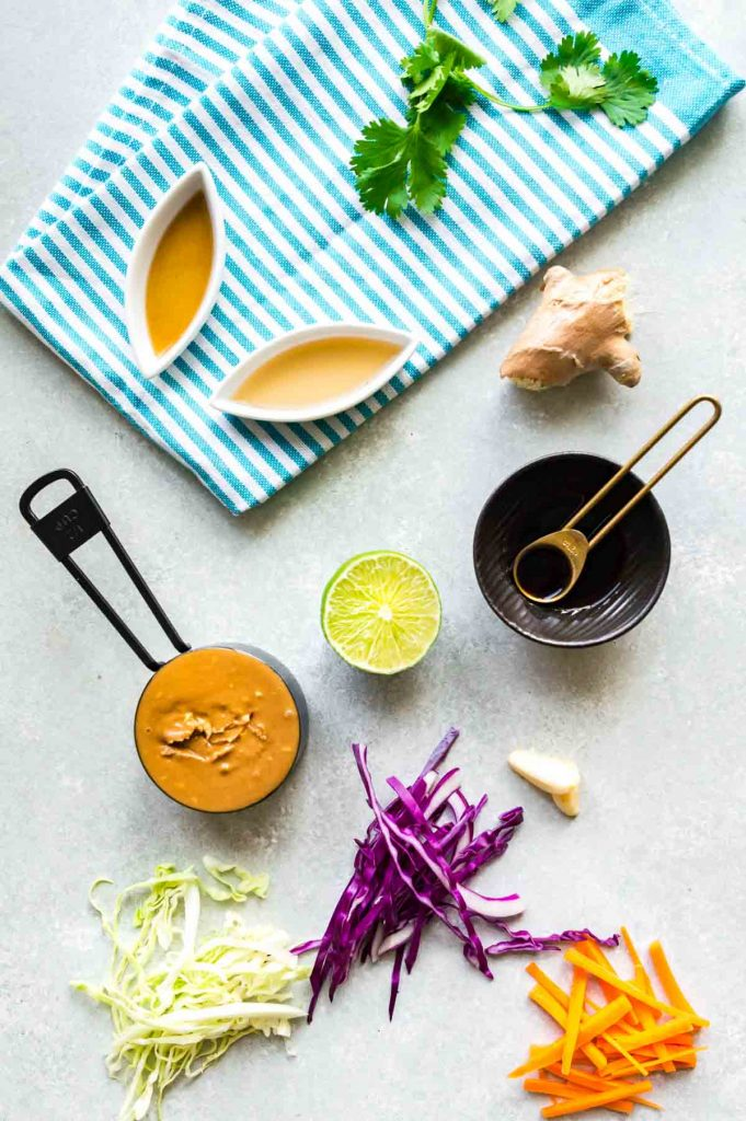 all ingredients for asian slaw on the table