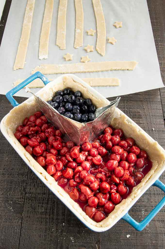baking dish with cherries and blueberries in a flag shape