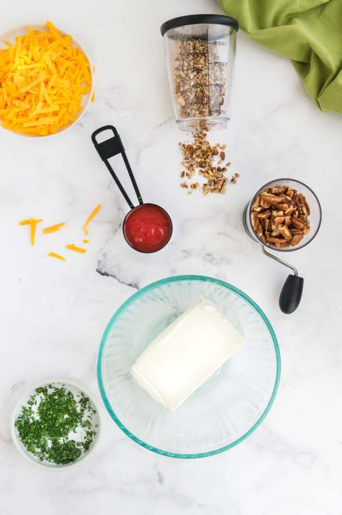 All ingredients to make a cheese ball with buffalo sauce cheese spread
