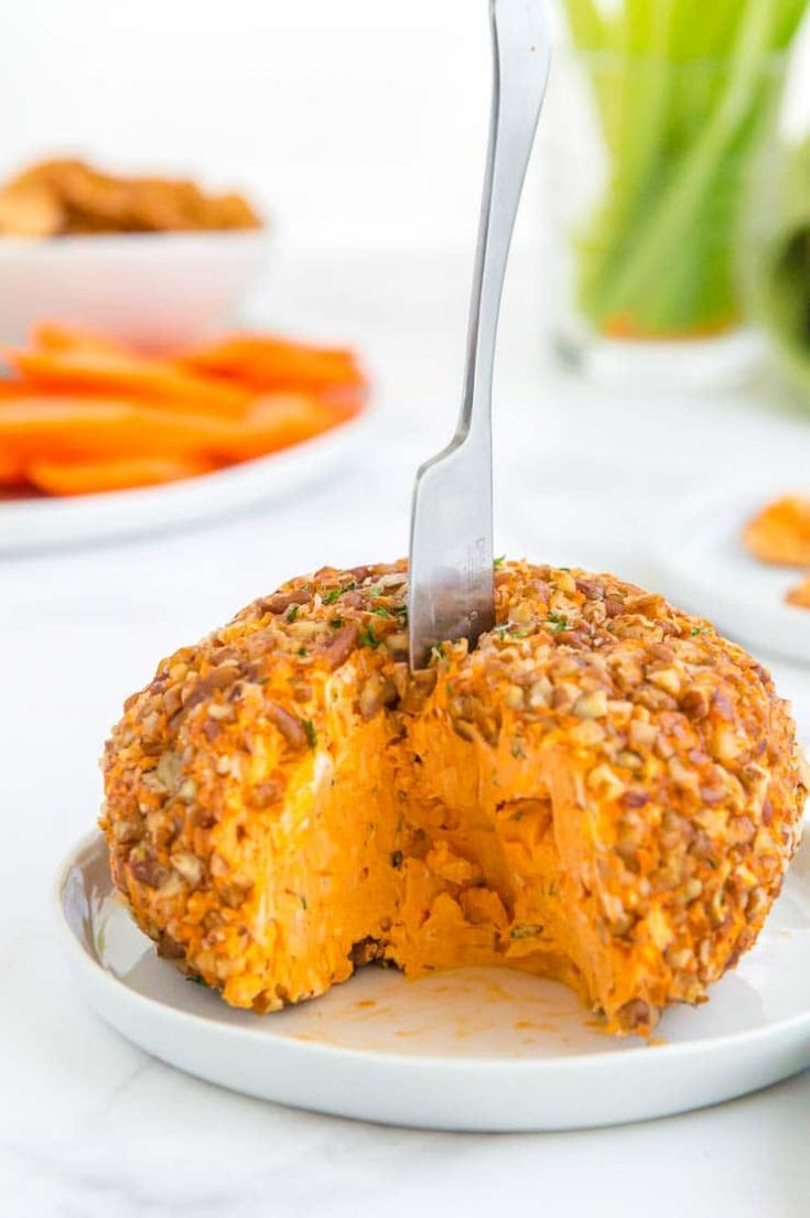 buffalo cheese ball with a wedge missing
