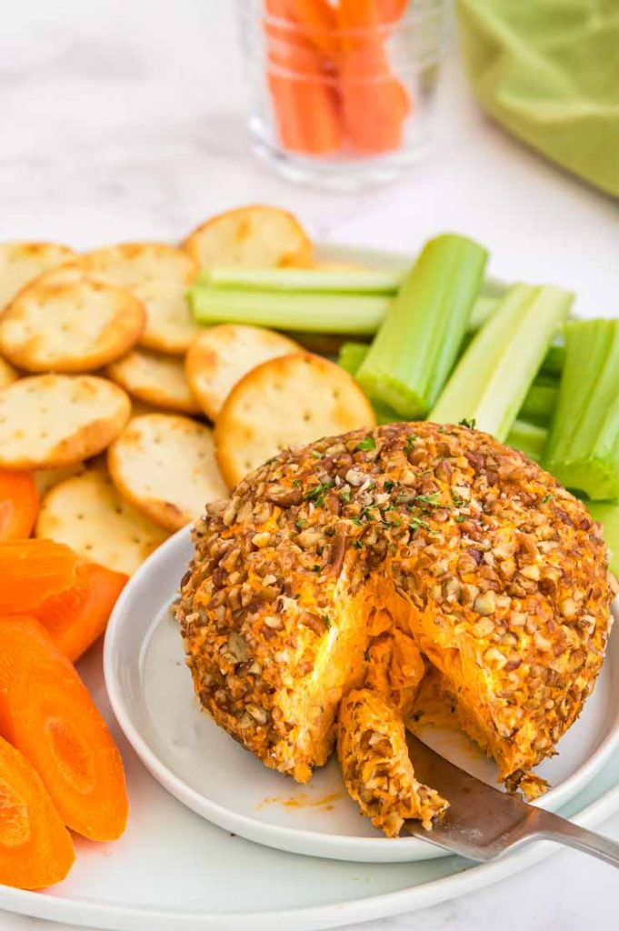 zoomed in pic of center of bright orange buffalo dip cheese ball