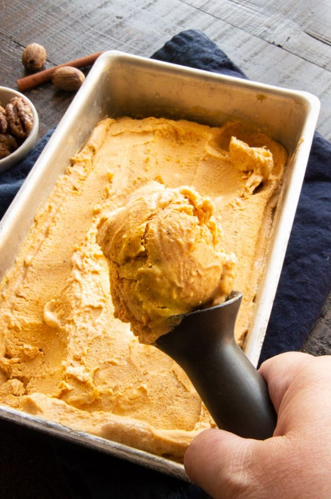 a large ice cream scoop with pumpkin ice in it