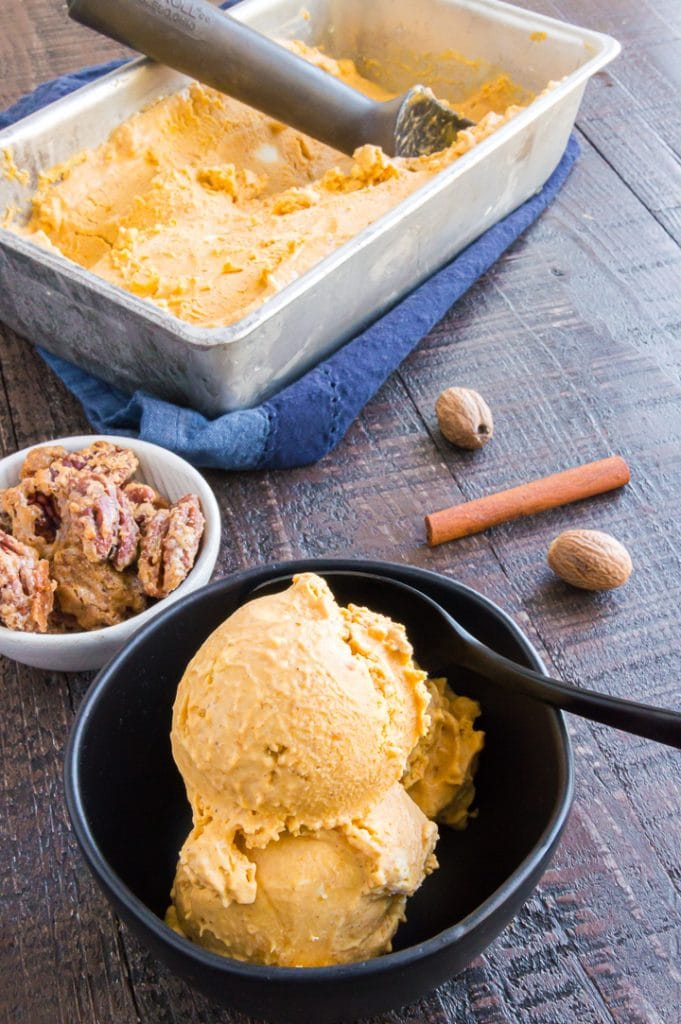 Ice cream made of pumpkin next to the loaf pan with more in it