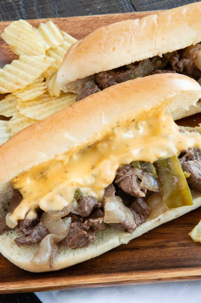 Cheese drizzled over philly Sammy