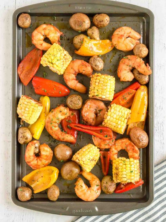tossing shrimp and veggies on the tray