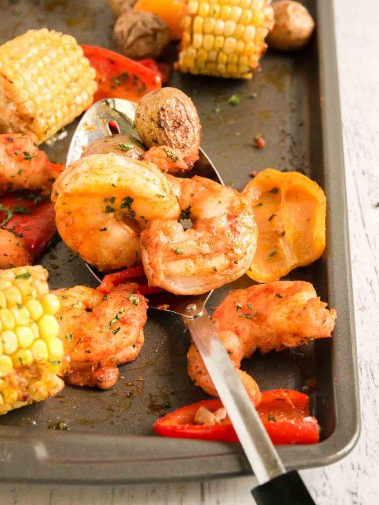 sheet pan shrimp with cajun seasoning on tray