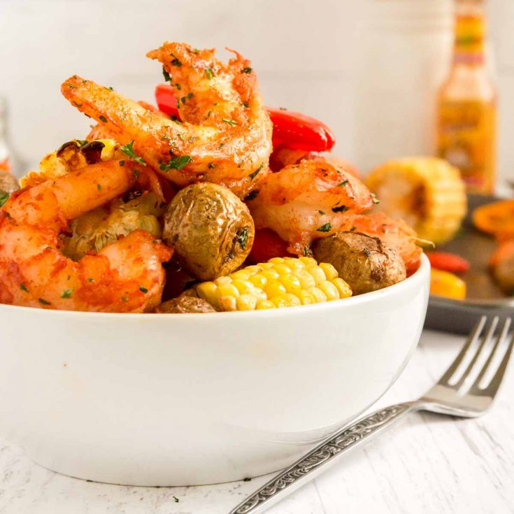 bowl of shrimp, corn and peppers