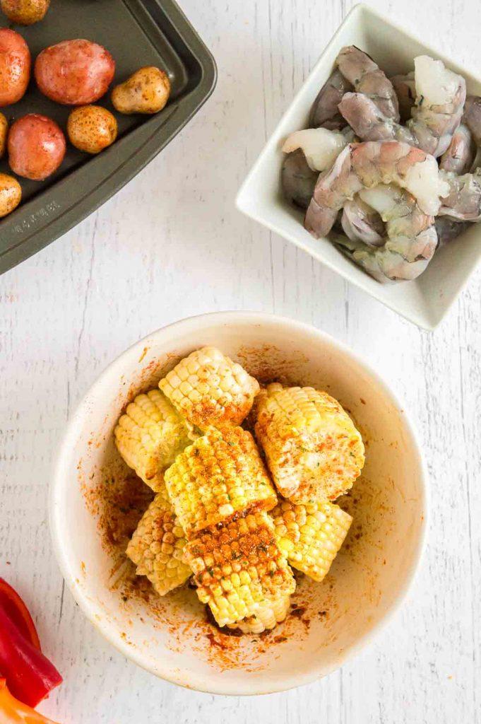 seasoning corn with cajun spices