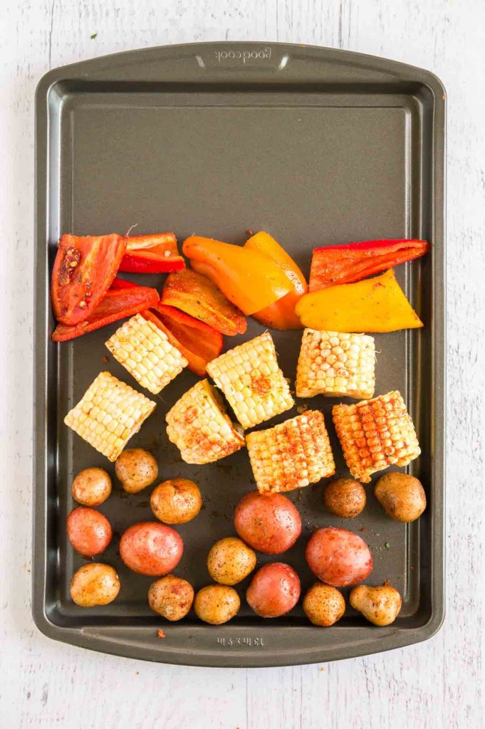 potatoes, peppers and corn on tray