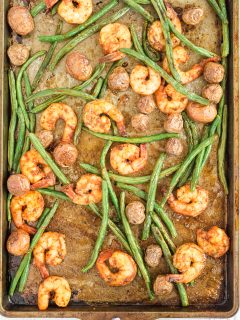sheet pan shrimp tossed on a tray