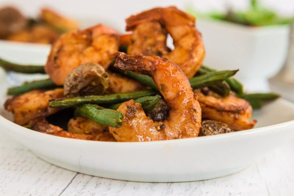 Single serving of shrimp, green beans and potatos on a table