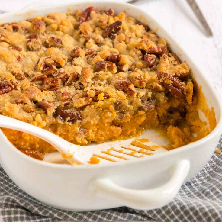 pan of sweet potatoes with pecan topping