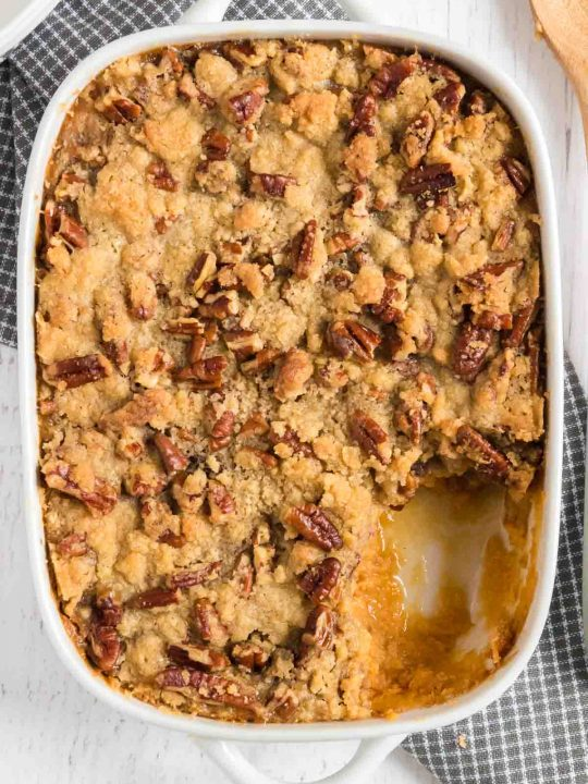 baking dish with sweet potato hot dish topped with pecans