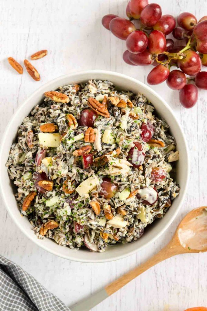Serving bowl of rice salad with pecans