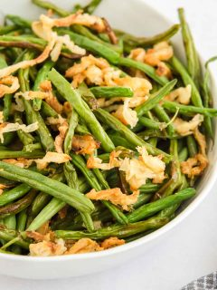 bowl of fresh green bean casserole with onions