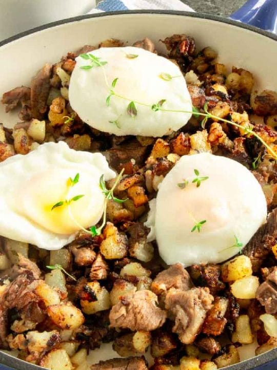 breakfast hash with poached eggs on top