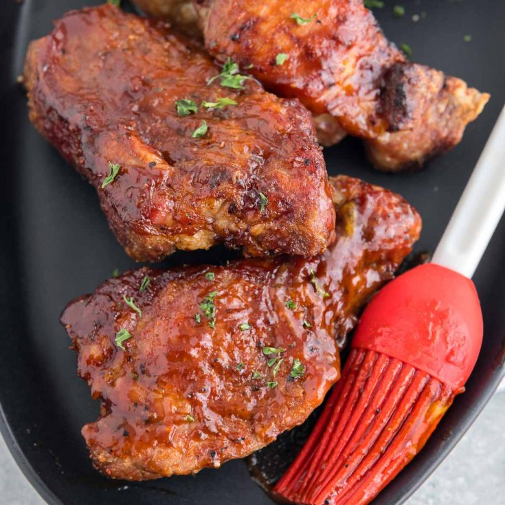 air fryer ribs on a plate with bbq sauce