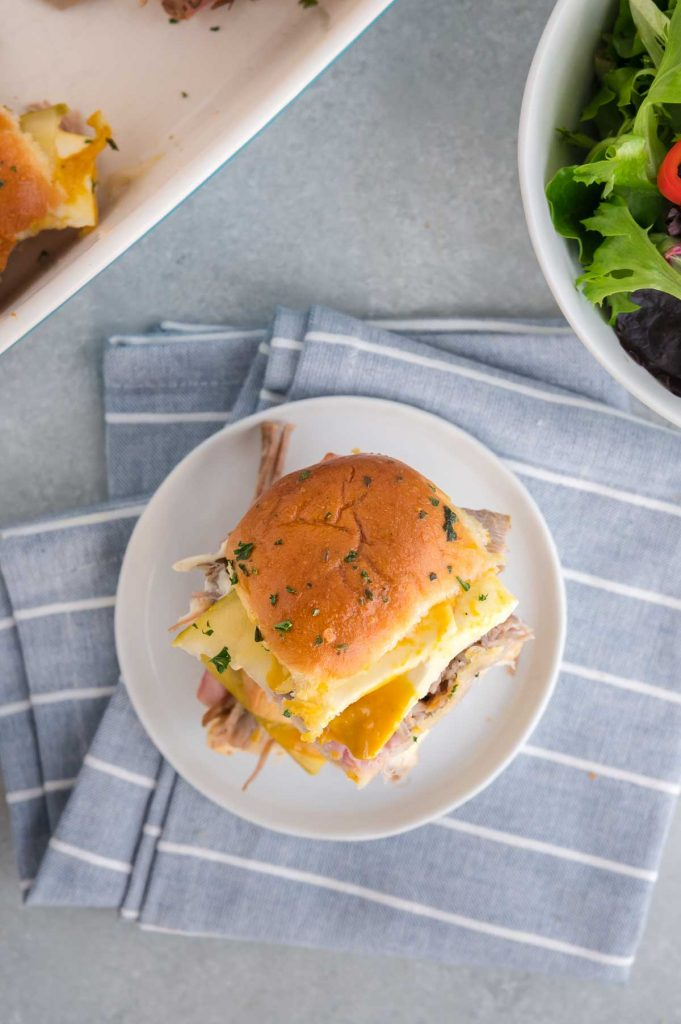 serving on ham and pork slider on a plate
