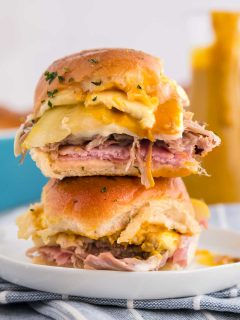 two Cuban sandwich sliders on a plate