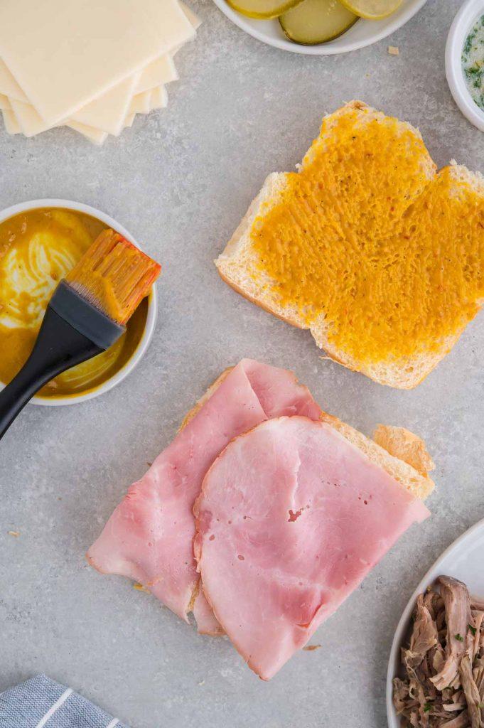 thin layers of ham on the Cuban sandwich