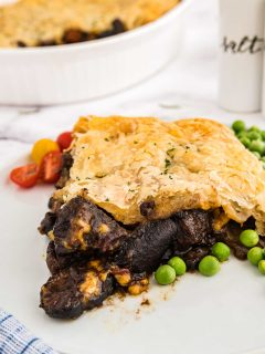 large serving of a guinness and beef casserole pie