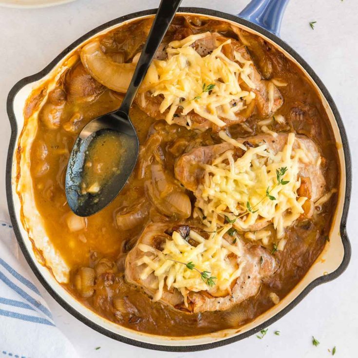 skillet full of pork chops somthered in French onion sauce