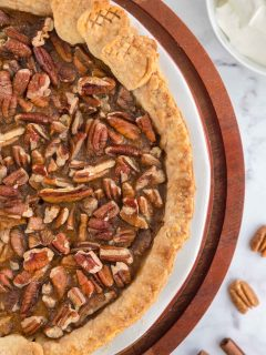 Sweet Potato Pecan Pie on a pie stand