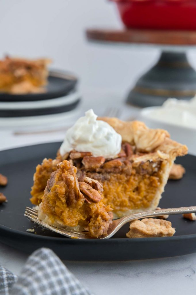 a spoonful of pecan sweet potato pie next to a lslice of pie